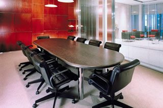 Business Black wood table with black leather chairs and woo - Water District Insurance